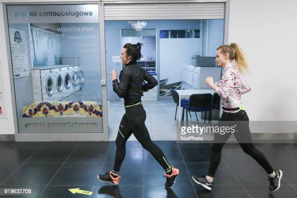 Runners running in front of launderette are seen in Gdansk Poland on 17 February 2018 Runners take part in the Manhattan Run run competition inside...