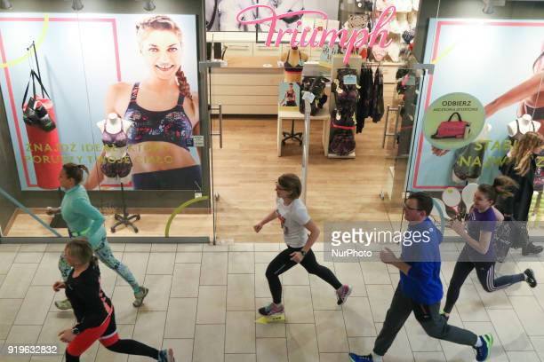 Runners running in front of Triumph shop are seen in Gdansk Poland on 17 February 2018 Runners take part in the Manhattan Run run competition inside...