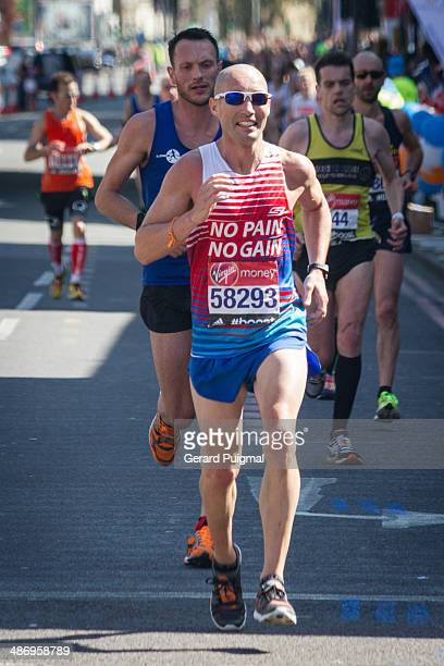 Runners running in The London Marathon 2014 in commercial road