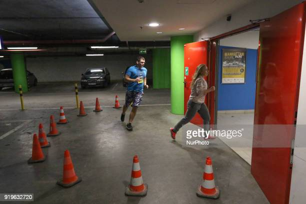 Runners running on the underground parking are seen in Gdansk Poland on 17 February 2018 Runners take part in the Manhattan Run run competition...