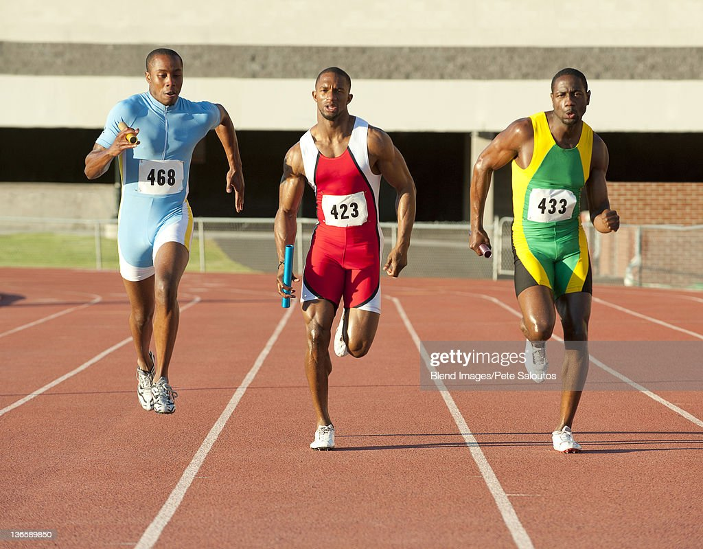Runners Running On Track In Relay Race Stock Photo Getty Images Basic Skills