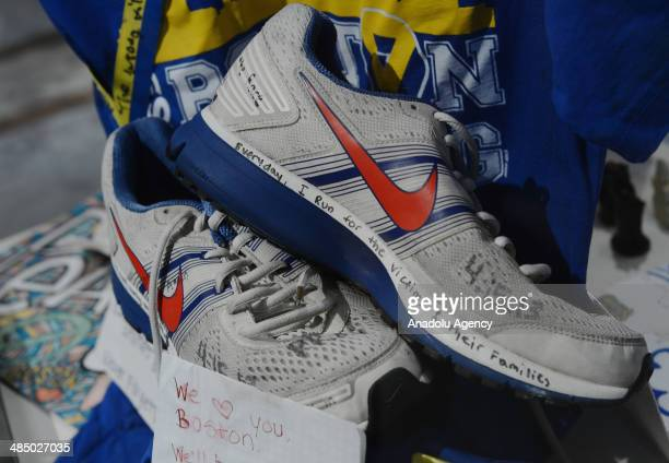 Runner's shoes and handwritten messages are seen in the Marathon Memorial Exhibit at the Boston Public Library to commemorate the 2013 Boston...