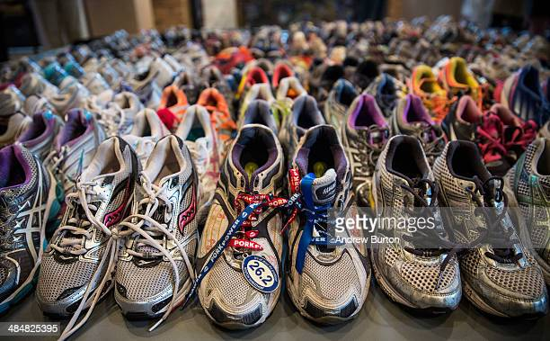 Runner's shoes are laid out in a display titled 'Dear Boston Messages from the Marathon Memorial' in the Boston Public Library to commemorate the...