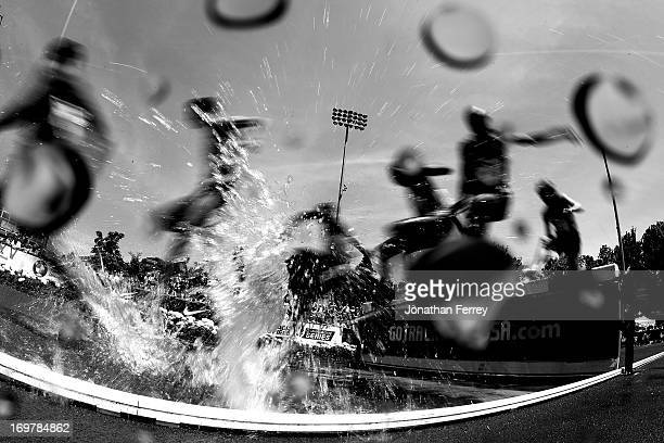 Runners splash through the water pit during the 3000m steeplechase during day 2 of the IAAF Diamond League Prefontaine Classic on June 1 2013 at the...