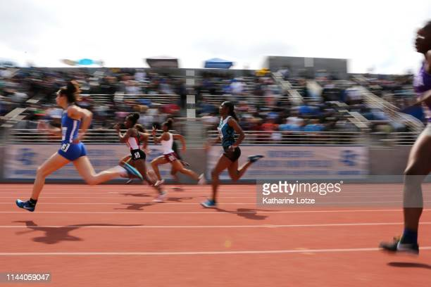 Runners sprint in the high school section of the girl's 100 meter dash on the second day of the 61st Mt SAC Relays at Murdock Stadium at El Camino...