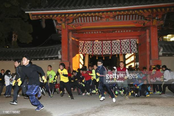 Runners sprint toward the main hall of Nishinomiya shrine in Nishinomiya, western Japan, on Jan. 10, 2020. The shrine has held the annual race for...