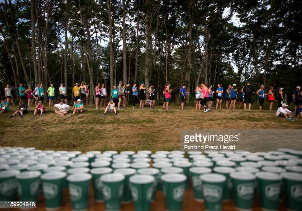 Runners stand in a long line for the porte-potties before the start of the annual Beach to Beacon 10K on Saturday, August 3, 2019.