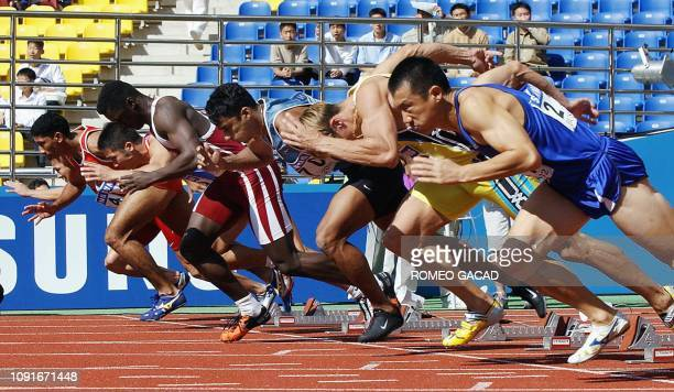 Runners start the second heat for the 100m men's race for the 14th Asian Games in Busan 07 October 2002 Saudi Aribian Jamal AlSaffar finished first...
