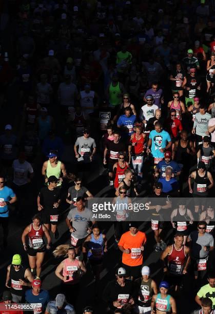 Runners start the the St Jude Rock 'n' Roll Nashville Marathon 1/2 Marathon on April 27 2019 in Nashville Tennessee