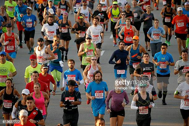 Runners start their run in the 2016 Bank of America Chicago Marathon on Sunday Oct 9 2016 in Chicago Ill