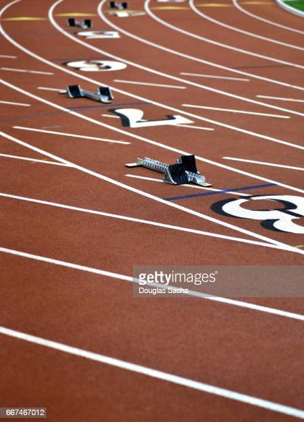 Runners starting blocks on the track and field turf