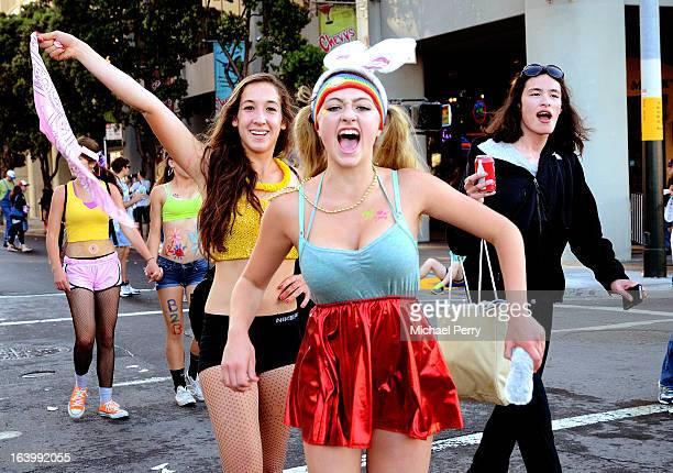 CONTENT] Runners stop to pose for cameras a few blocks from the start of the annual Bay to Breakers foot race along Howard Street in downtown San...