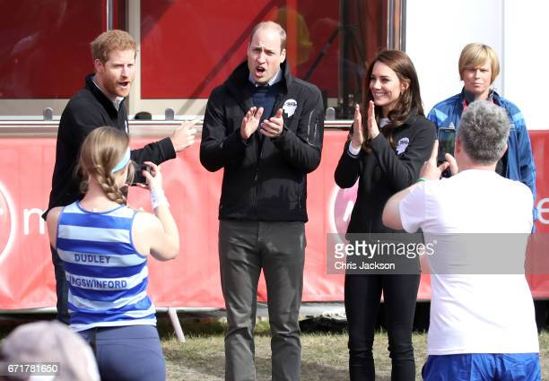 Runners stop to take pictures of Prince Harry Prince William Duke of Cambridge and Catherine Duchess of Cambridge as they cheer on runners at the...