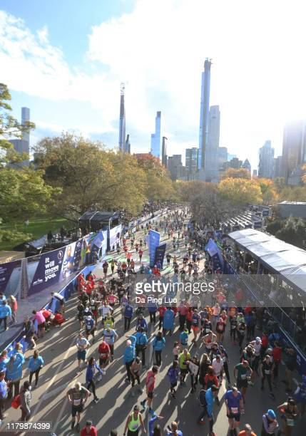 Runners stream over the finish line during the TCS New York City Marathon on November 3, 2019 in New York City.