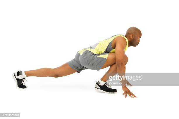 runner's stretch - black shorts stock pictures, royalty-free photos & images