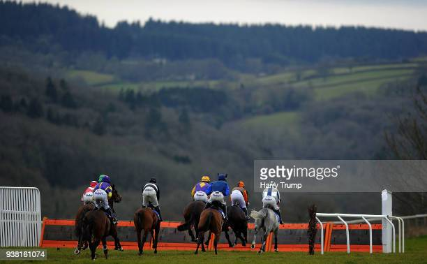 Runners take a flight during the JacksonStops Taunton Handicap Hurdle Race at Taunton Racecourse on March 26 2018 in Taunton England