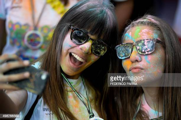 Runners take a selfie during the Color Run in Caracas on November 22 2015 AFP PHOTO/FEDERICO PARRA