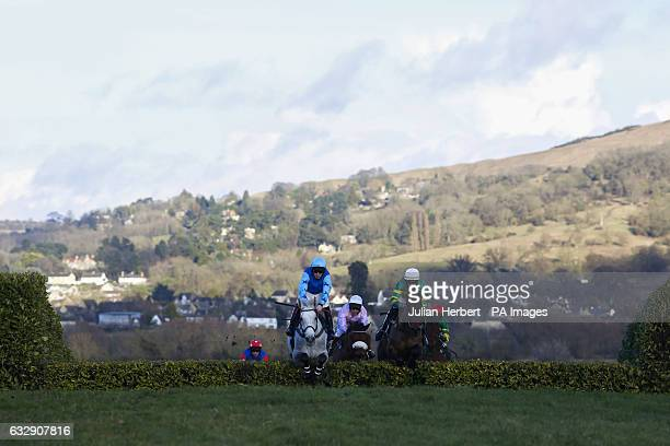 Runners take an early jump during The Glenfarclas Cross Country Handicap Steeple Chase Race run during Festival Trials Day at Cheltenham Racecourse