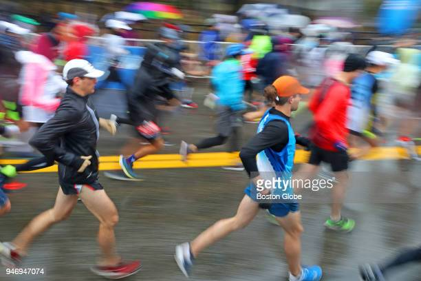 Runners take off at the start line of the Boston Marathon in Hopkinton MA on April 16 2018