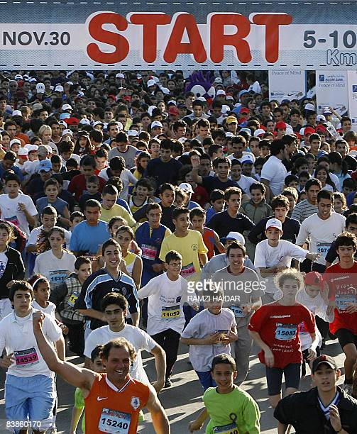 Runners take off at the starting line of the annual Beirut International Marathon in the Lebanese capital on November 30 2008 AFP PHOTO/RAMZI HAIDAR