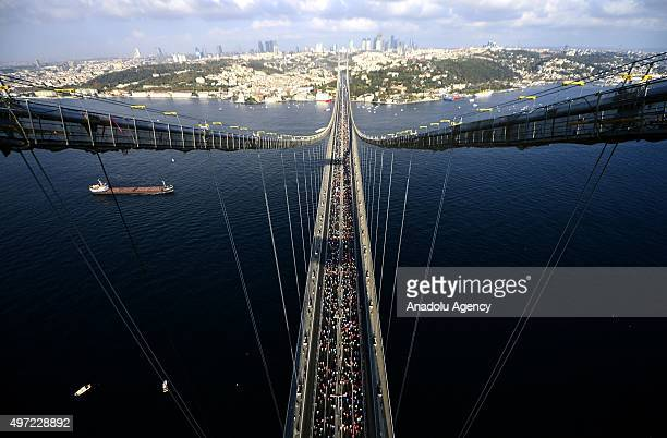 Runners take part in 37th Vodafone Istanbul Marathon one of the top 10 marathons in the world on the Bosphorus Bridge in Istanbul Turkey on 15...