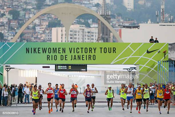 Runners take part in a marathon test event for the Rio 2016 Olympic Games at the Sambodromo on April 10 2016 in Rio de Janeiro Brazil The traditional...