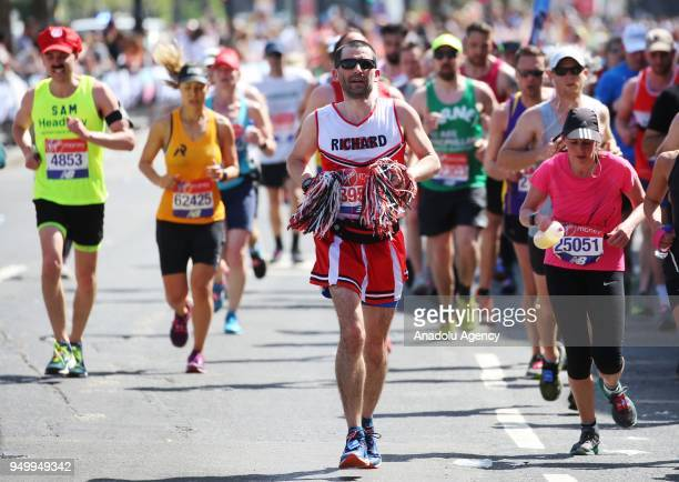 Runners take part in the 2018 London Marathon on its way through Tower Hamlets London United Kingdom on April 22 2018