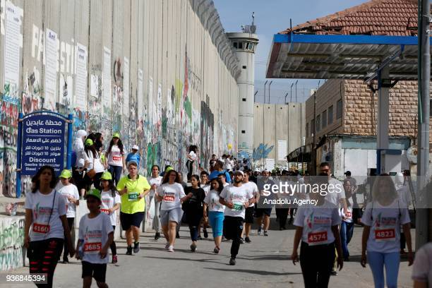 Runners take part in the 6th International Palestine Marathon which started in front of El Mehd Church in Bethlehem West Bank on March 23 2018