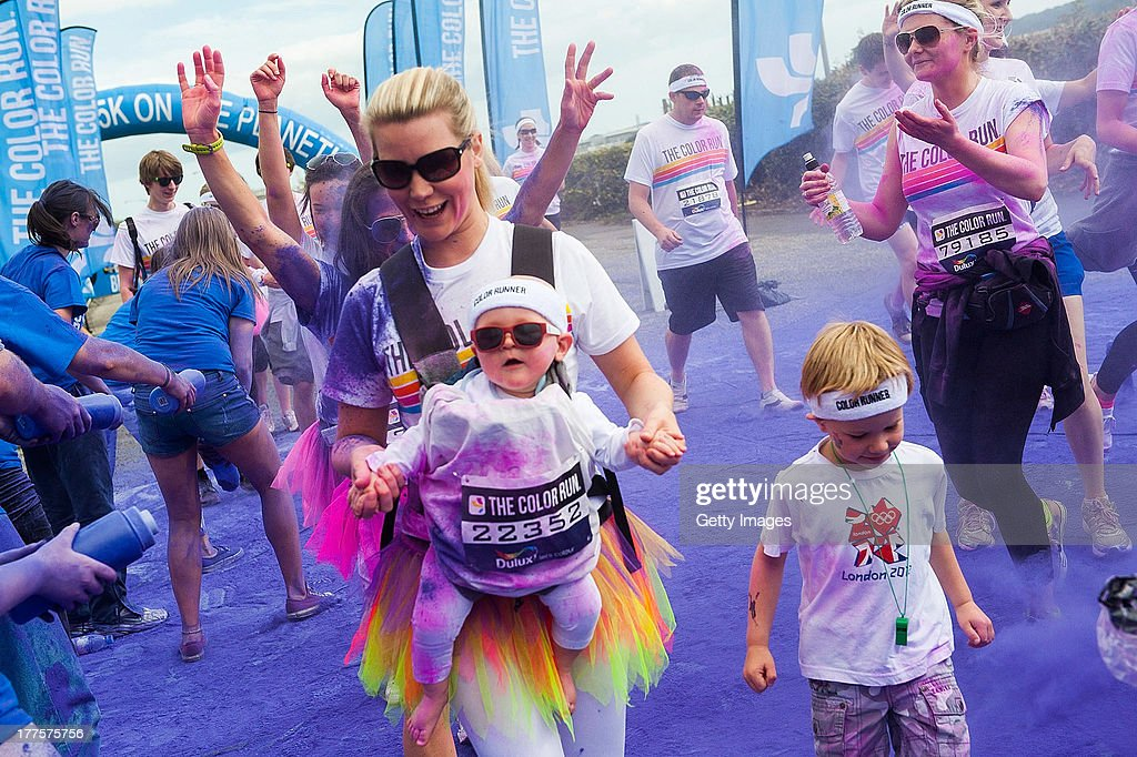Runners take part in the Color Run on August 24, 2013 in Belfast, Northern Ireland. Known as the happiest 5km on the planet, runners of all shapes, sizes and speeds wearing white clothing that is a blank canvas for the kaleidoscope of colours they encounter around The Colour Run course. At each kilometer a different colour of powder is thrown in the air with the runners becoming a constantly evolving artwork. At the end of the course runners are greeted by the Colour Festival where the air is filled with music and stunning colour powder bursts creating a vibrant party atmosphere.