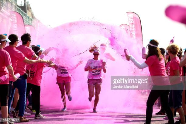 Runners take part in the Color Run presented by Dulux known as the happiest 5km on the planet on September 20 2014 in Brighton England Runners of all...