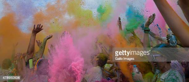 Runners take part in the Colour Run on June 27 2015 in Warsaw Poland The Colour Run also known as the Happiest 5k on the Planet is a unique race...