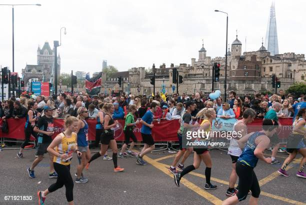 Runners take part in the Virgin Money London Marathon running pass the Tower of London in London England on April 23 2017