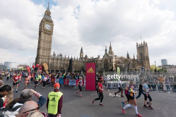 Runners take part in the Virgin Money London Marathon running pass Big Ben and the Houses of Parliament in London England on April 23 2017
