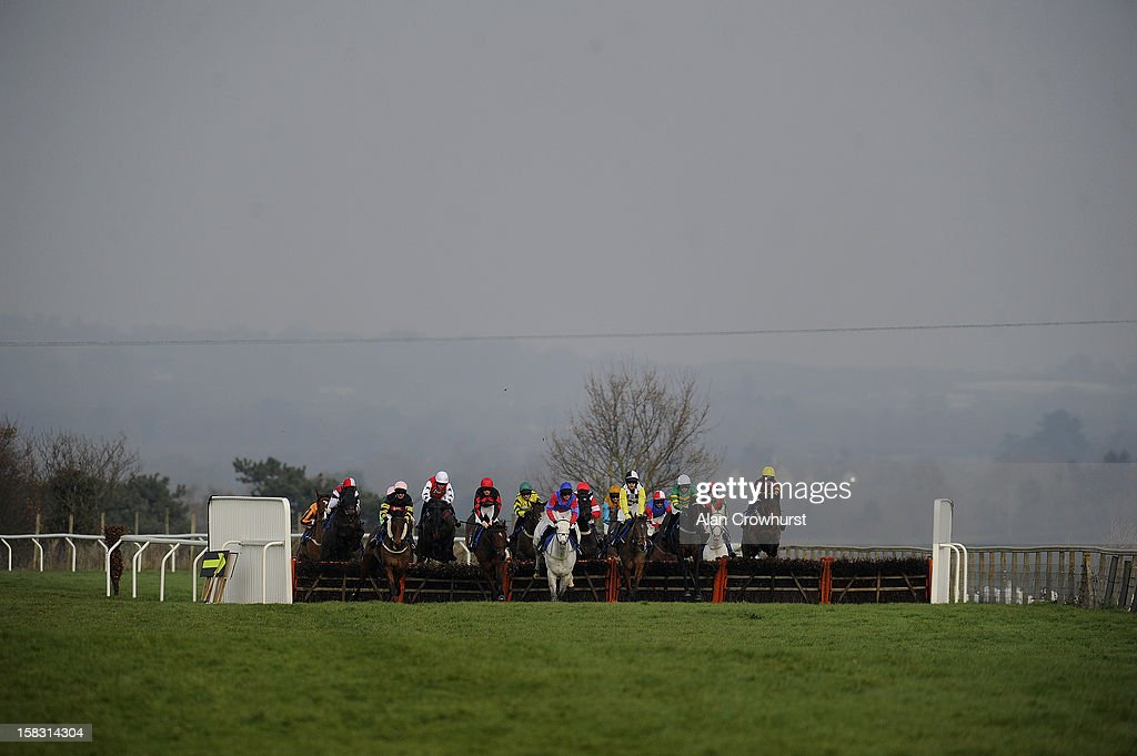 Runners take the first flight of hurdles in The Bathwick Tyres Taunton Handicap Hurdle Race at Taunton racecourse on December 13, 2012 in Taunton, England.