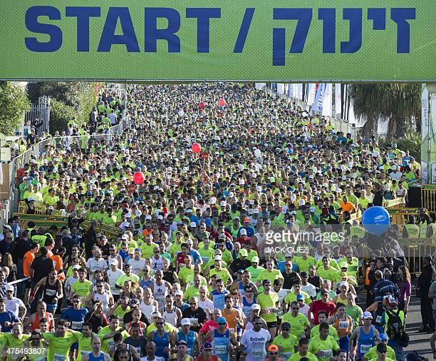 Runners take the start of the 2014 Tel Aviv Marathon on February 28 2014 in the Mediterranean coastal city of Tel Aviv Tens of thousands of runners...