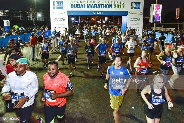 Runners take the start of the Dubai Marathon in the Gulf emirate on January 20 2017 Middle distance legend Kenenisa Bekele who was aiming to add the...