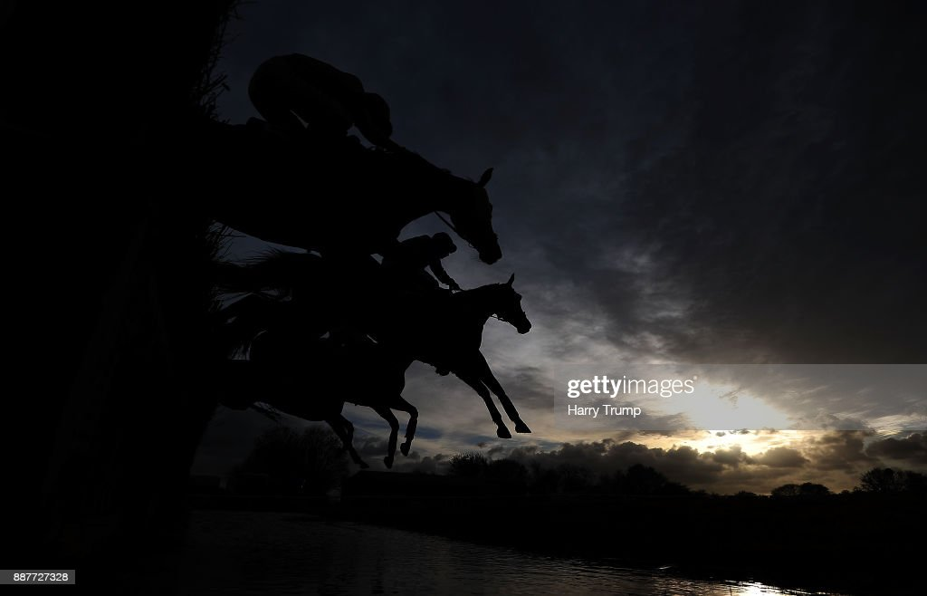 Runners takes the water jump during the Crestmoor Construction Handicap Chase at Wincanton Racecourse on December 7, 2017 in Wincanton, England.