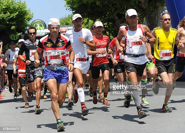 Runners tale the start of the 26km race of 40th edition of the Course des Cretes race on July 4 2015 in Espelette southwestern France Some 5000...