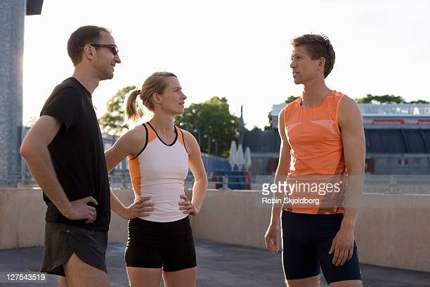 Runners talking together