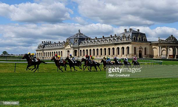 Runners turn away from the Les Grandes Ecuries and make their way into the straight at Chantilly racecourse on June 02 2013 in Chantilly France