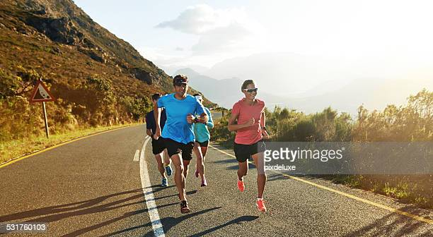 runners understand each other - triathlon stock pictures, royalty-free photos & images
