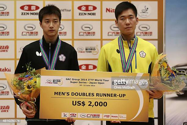 Runners up, Chiang Hung-Chieh and Huang Sheng-Sheng of Taipei pose on the podium after their match against Jun Mizutani and Kishikawa Seiya of Japan...