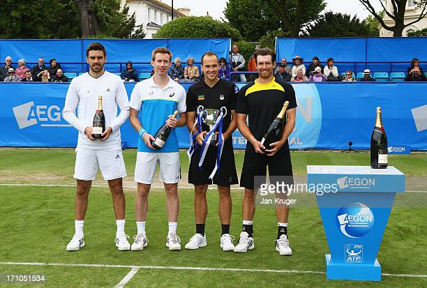 Runners up Colin Fleming and Jonathan Marray of Great Britain pose with winners Bruno Soares of Brazil and Alexander Peya of Austria after their...