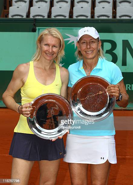 Runners up Jana Novotna of Czech Repulic and Martina Navratilova of USA pose with the trophies following their defeatduring the women's legends final...