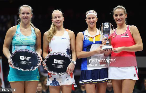 Runners up Kiki Bertens of Netherlands and Johanna Larsson of Sweden and winners Andrea Hlavackova of Czech Republic and Timea Babos of Hungary pose...
