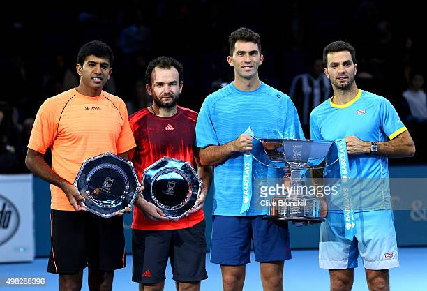 Runners up Rohan Bopanna of India and Florin Mergea of Romania pose alongside the winners Horia Tecau of Romania and JeanJulien Rojer of France...