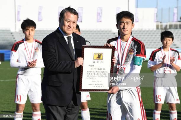 Runners up Zweigen Kanazawa captain Yusei Funo receives the award from JFA president Kozo Tashima after the Prince Takamado Trophy 30th U15 Japan...