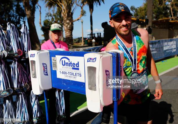 Runners use hand sanitzer after finishing the 2020 Los Angeles Marathon on March 08 2020 in Los Angeles California