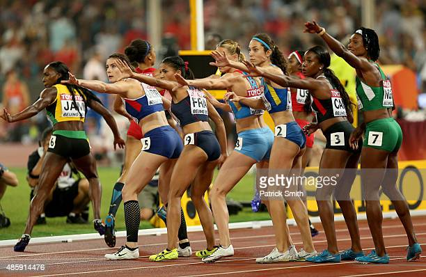 Runners wait for the change over in the Women's 4x400 Relay Final during day nine of the 15th IAAF World Athletics Championships Beijing 2015 at...
