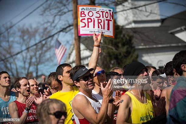 Runners wait for the start gun at the beginning of the Boston Marathon on April 21 2014 in Hopkington Massachusetts Today marks the 118th Boston...